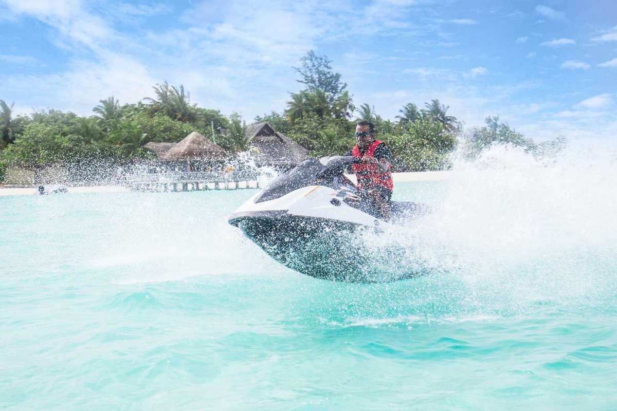 A man jet-skiing through the water