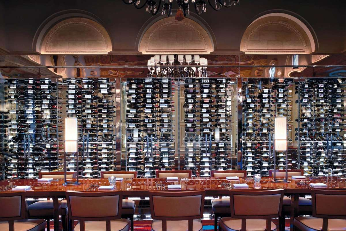 View on one wand of the HMF Restaurant at the Breakers Hotel, completely covered with wine bottles