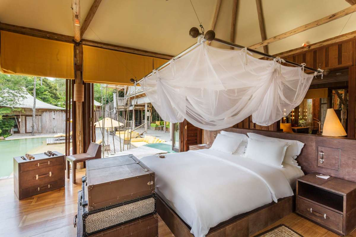 View on the bed in the master bedroom of one of the Pool Reserves at Soneva Kiri
