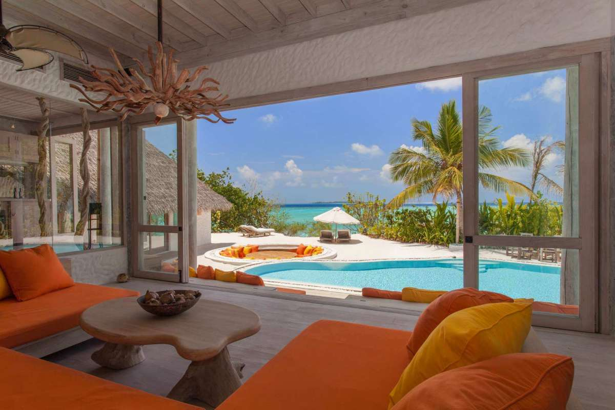 The inviting interior of the relax area with sea view at Soneva Fushi