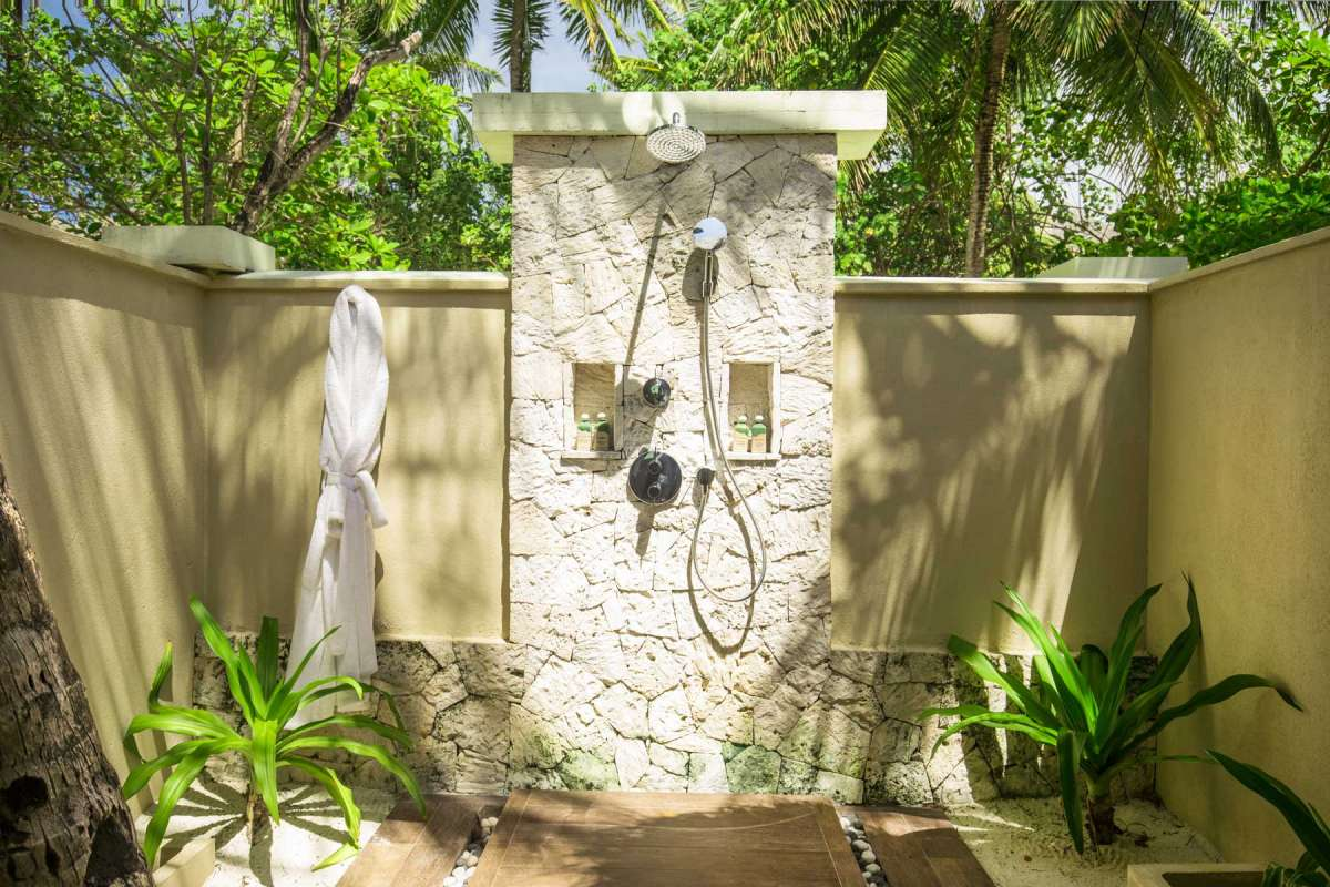 View of the outdoor shower of a premium villa at the Taj Exotica Resort & Spa in the Maldives