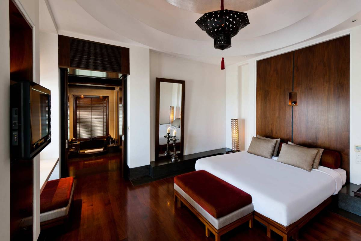 View into the bedroom of one of the Club Suites at The Chedi Muscat