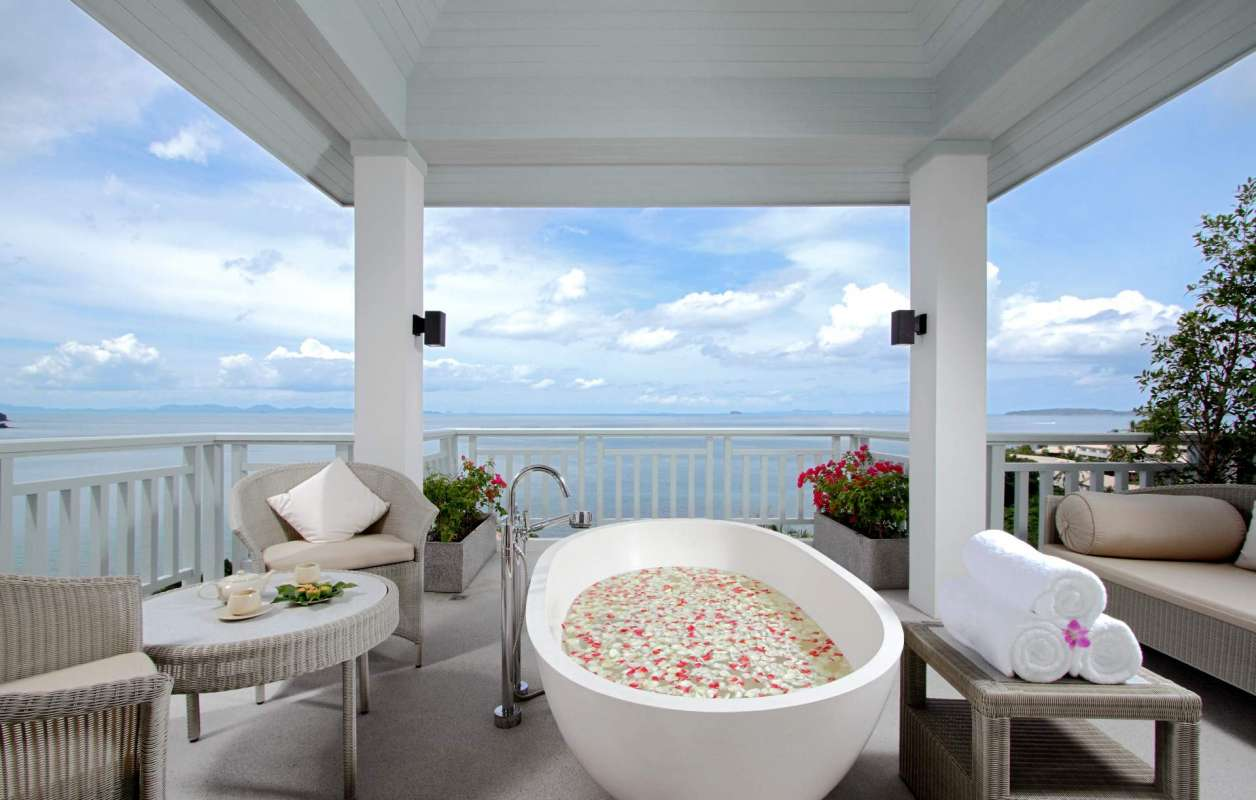 View on a tub already prepared with flowers at the outside-located Treatment Suite of Amatara Wellness Resort including ocean view