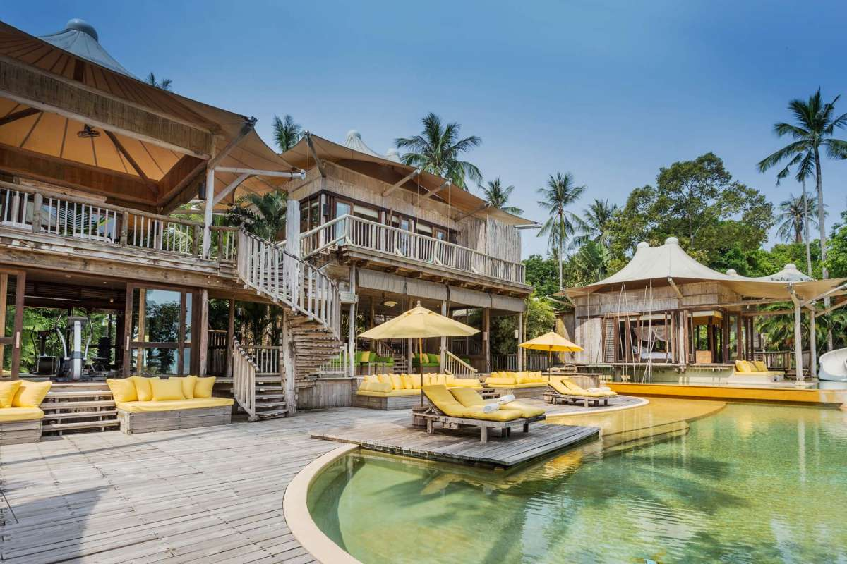 View on the area around the pool at Soneva Kiri, including a view on the fitness room
